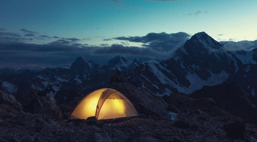 tent on mountain at night time