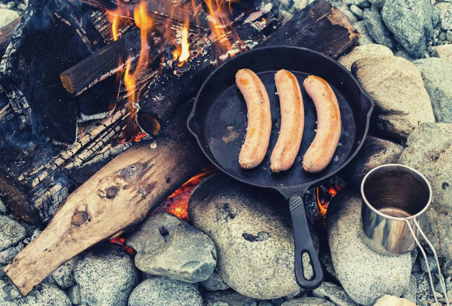 camp cooking with cast iron featimage