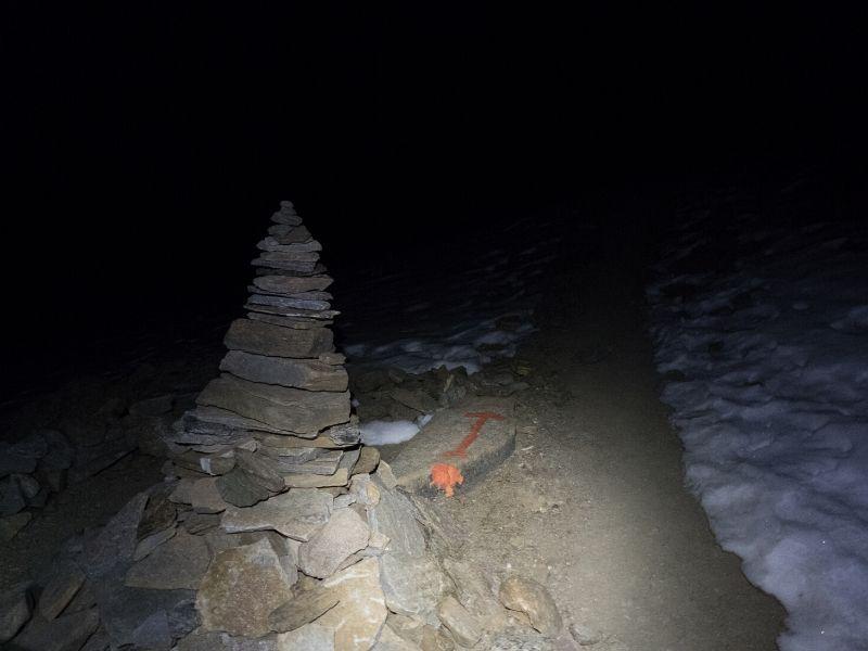 rock-cairn-at-night-alps-intext