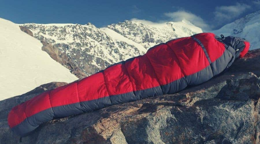 sleeping bag sitting on rockface