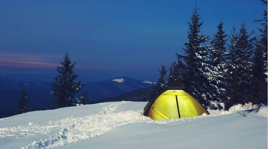 tent on snowy hillside - In Text