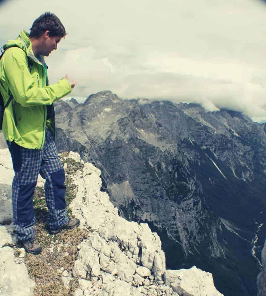 hiker overlooking cliff edge