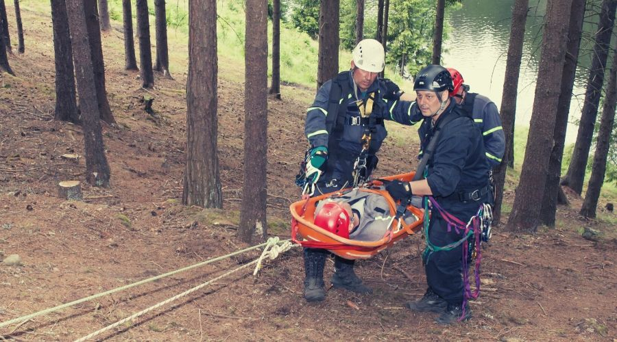 man on stretcher in forest