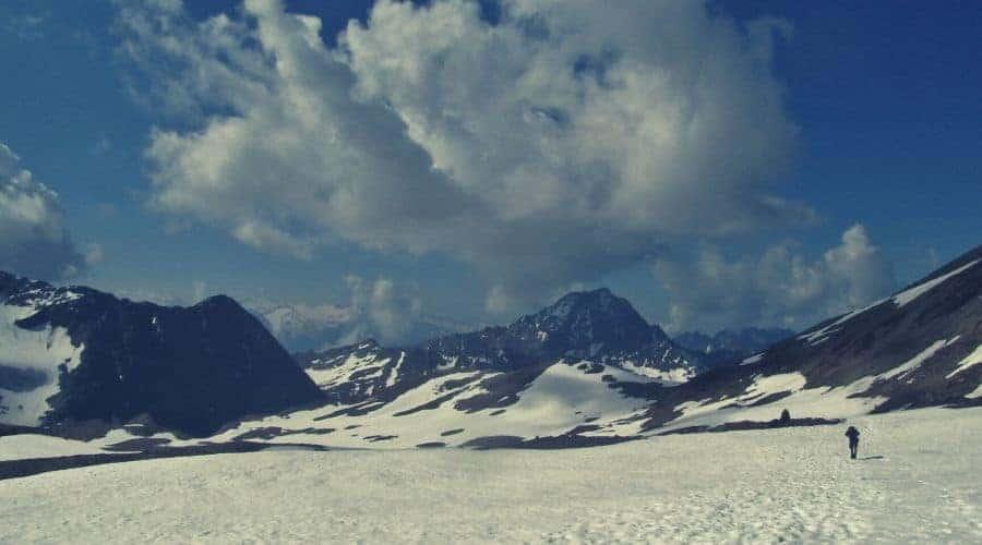 hiker cairn snowfield intext