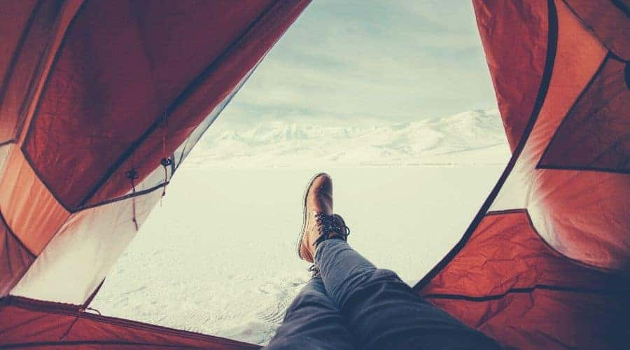 view of snowy landscape from tent entrance intext