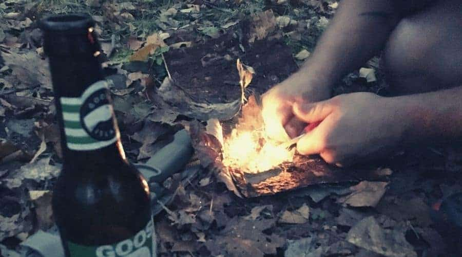 Man starting a fire with flint