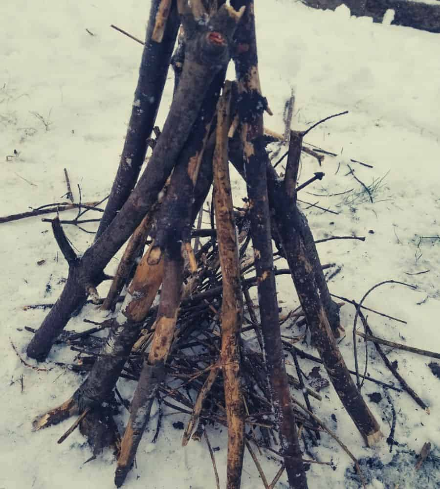 Teepee style campfire waiting to be lit