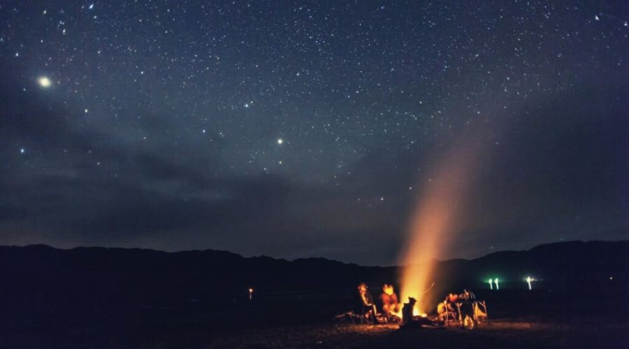 night camping under the stars Mountains intext
