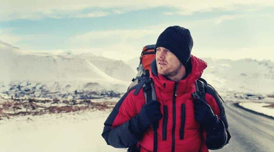 backpacker wearing 3 layered clothing system intext