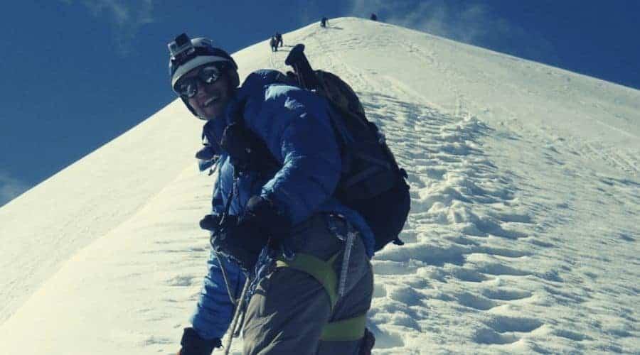 mountaineer in waterproof clothing intext