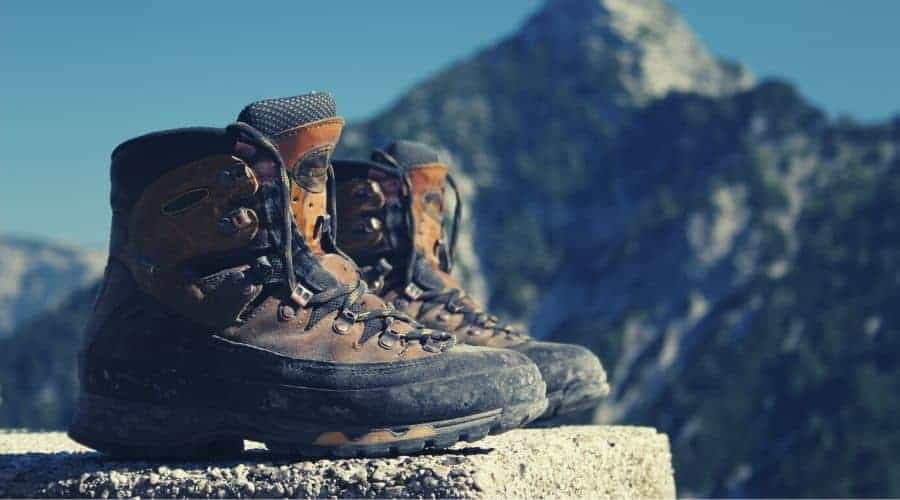 pair of hiking boots sitting on rock