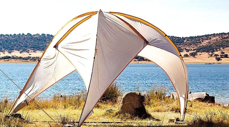 Pop Up Shade shelter blowing in wind - In Text