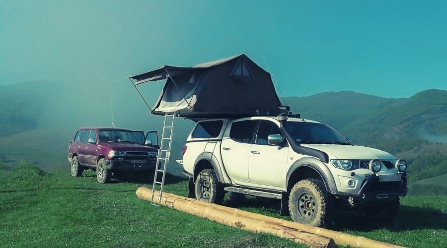 tent on top of suv truck intext