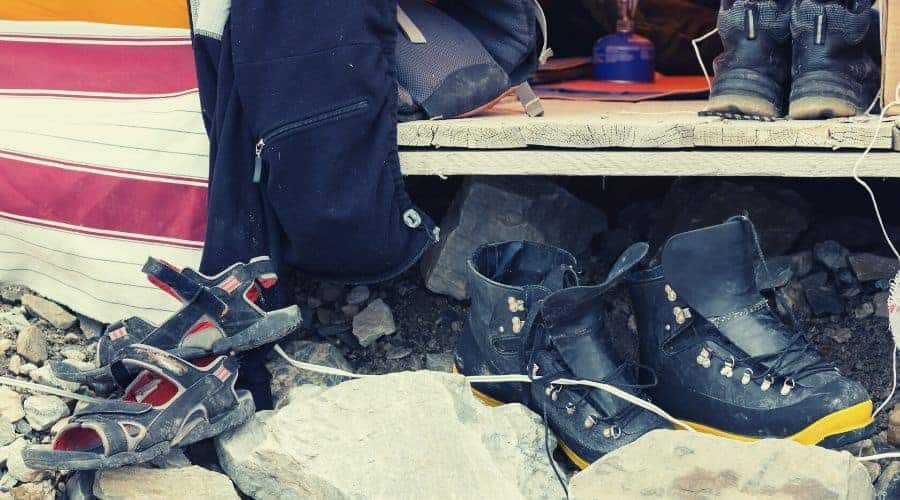 hiking boots & sandals outside tent intext