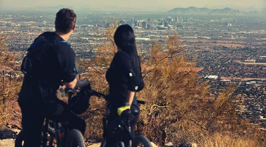 two cyclists view of Phoenix on the holbert trail intext