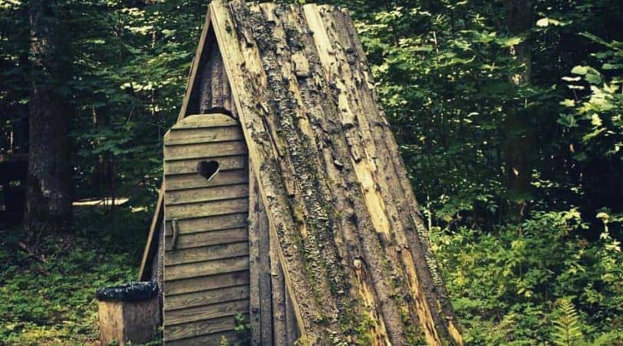 outhouse in forest intext