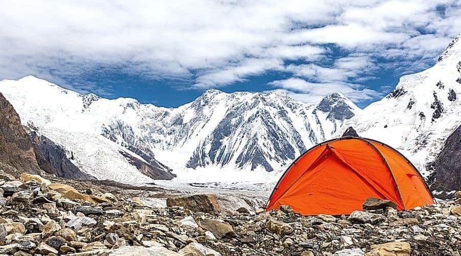 tent on cold mountain scree - In Text
