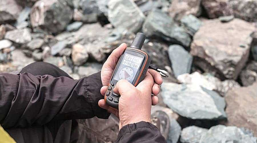 Man Holding GPS unit - In Text