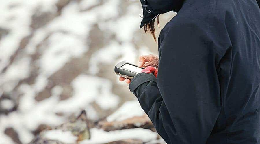Woman Holding GPS unit - In Text