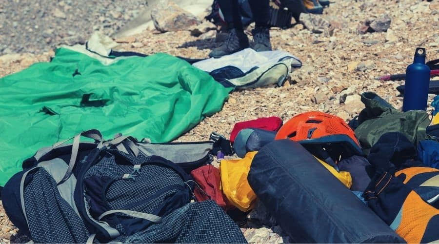 backpacking gear on mountainside closeup