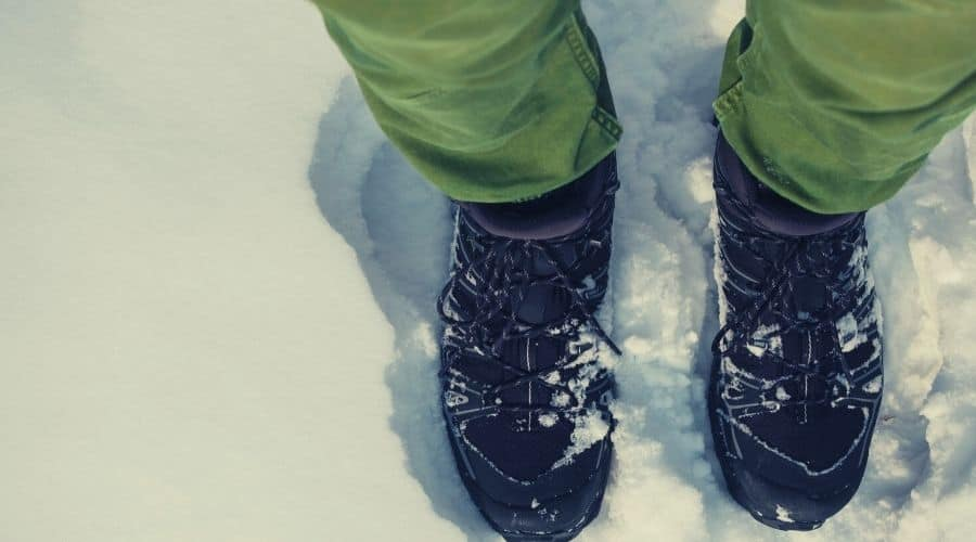 hiking boots in deep snow