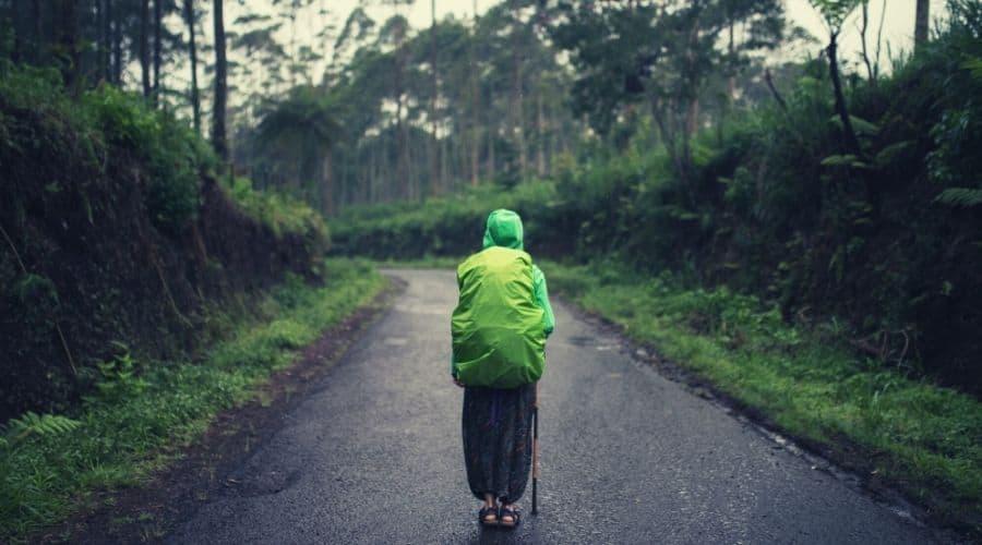 women hiking with rain poncho on