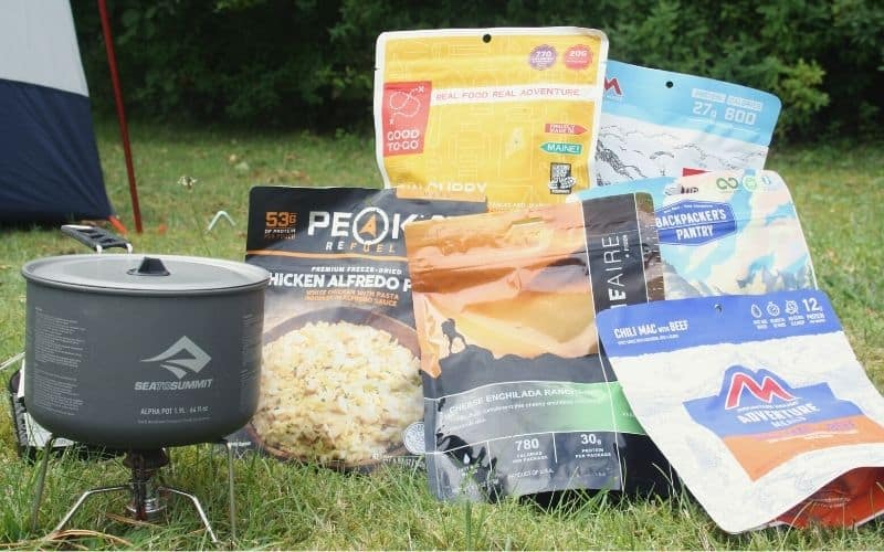 Backpacking stove and backpacking meals outside tent
