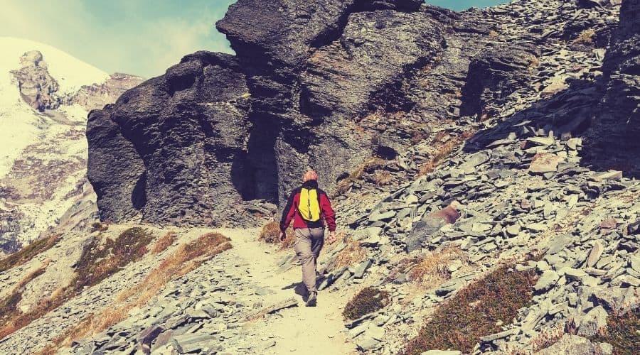hiker walking along scree path