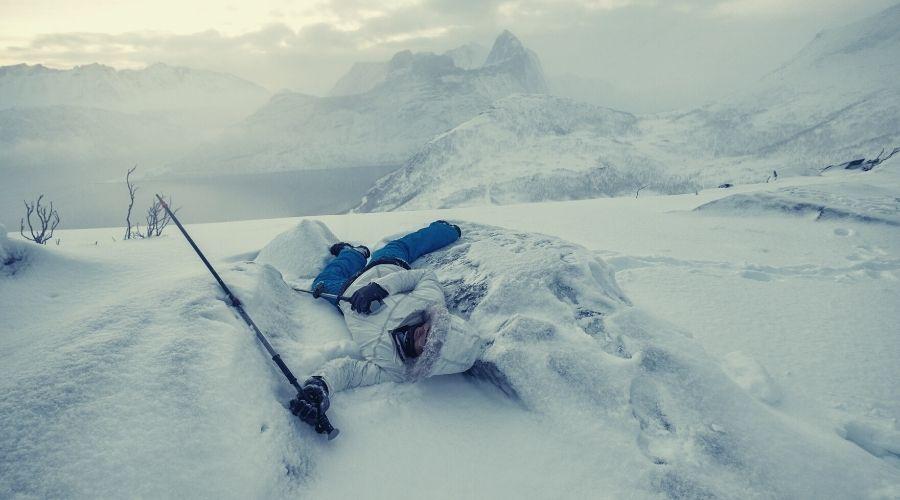 hiker fallen over in the snow