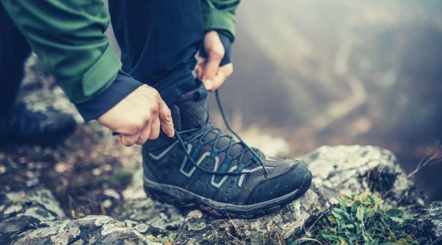hiker lacing hiking boots