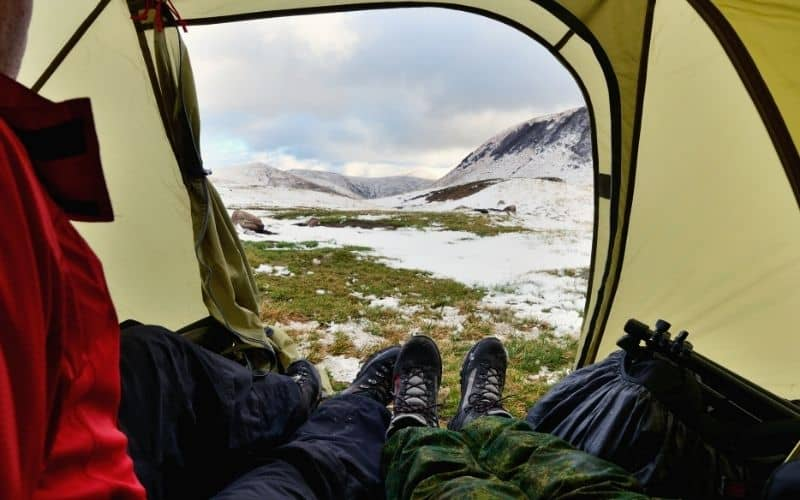 looking out at snowfield from tent