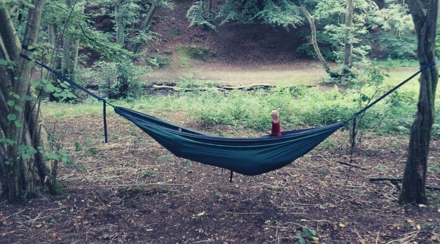 woman chilling in a hammock in the forest