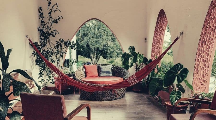 fabric hammock hanging in porch of house