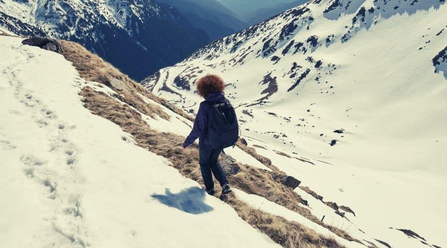 women hiking along snowy pass