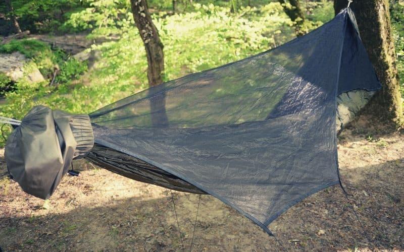 hammock bug net over hammock in forest