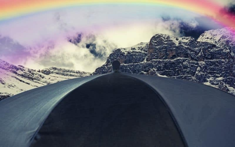 rainbow over umbrella and mountain