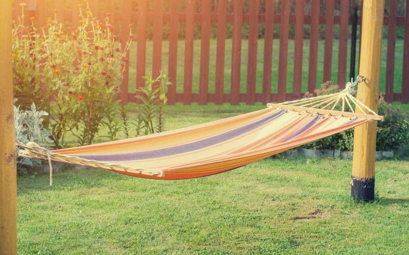 hammock hanging in garden from two posts