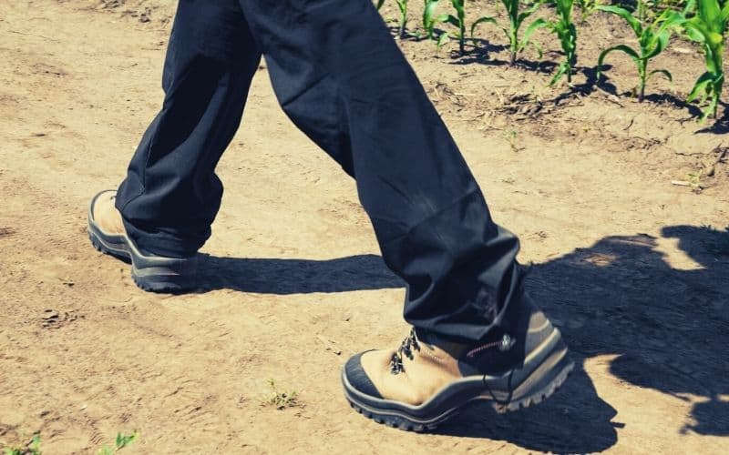 hiker wearing dark hiking pants with draw string bottoms