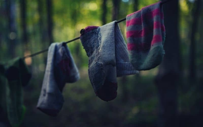 wool hiking socks hanging on line in forest