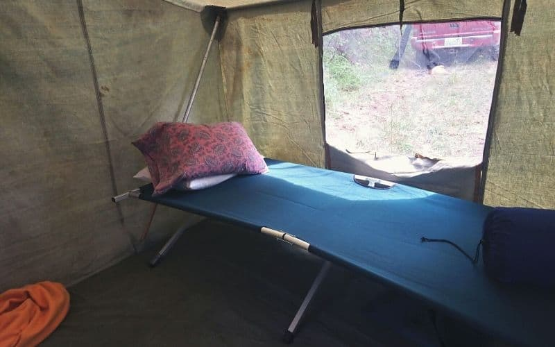 another camping cot in a tent