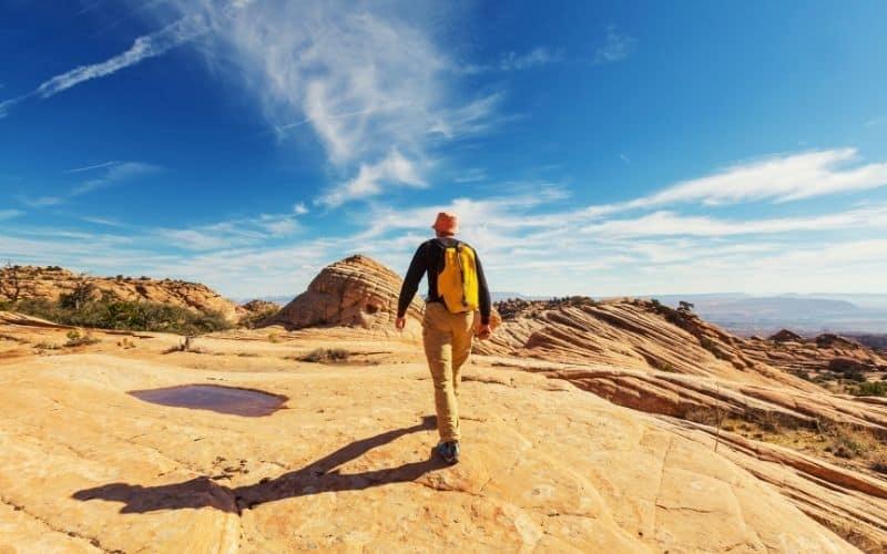 hiker-hiking-across-rocky-desert-with-bucket-hat