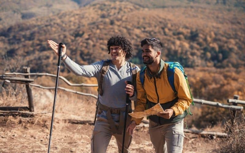 Two hikers checking directions