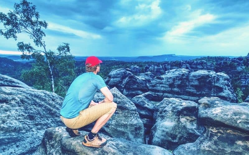 hiker overlooking rock canyonns