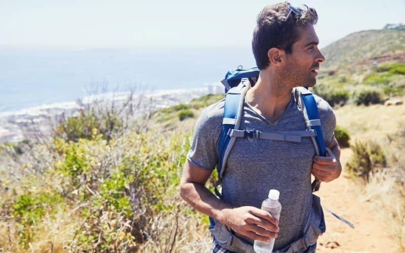 hiker with water hiking coastal trail